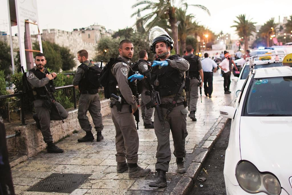 Israeli border police and rescue forces at the scene of a terrorist attack near Damascus Gate in Yerushalayim's Old City on Wednesday. (Yonatan Sindel/Flash90)