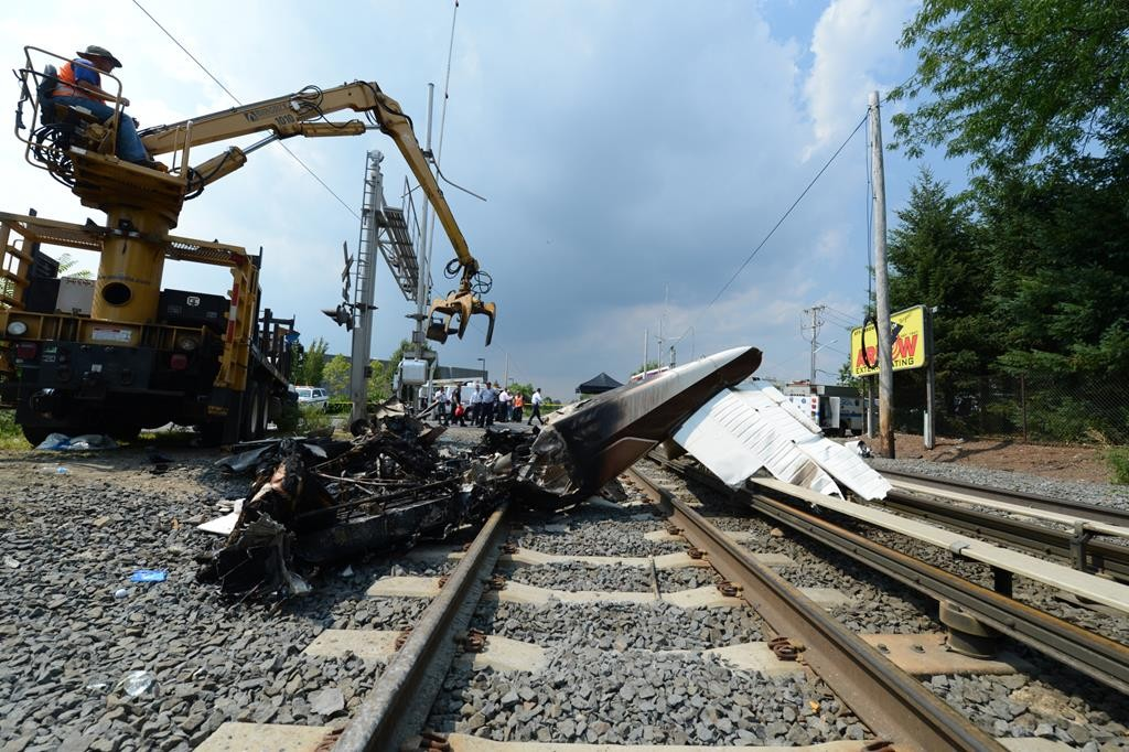 A tractor removes the remnants of a small plane that crashed on Sunday onto the main Long Island Railroad line in Hicksville. (MTA)