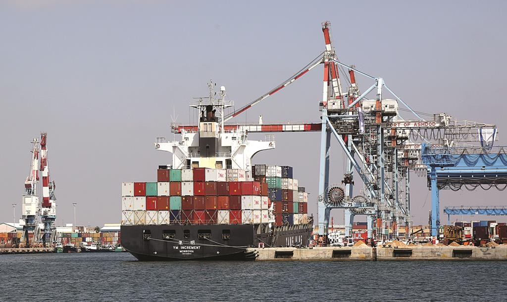 A cargo ship docked at the port in Ashdod. (Edi Israeli/FLASH90)