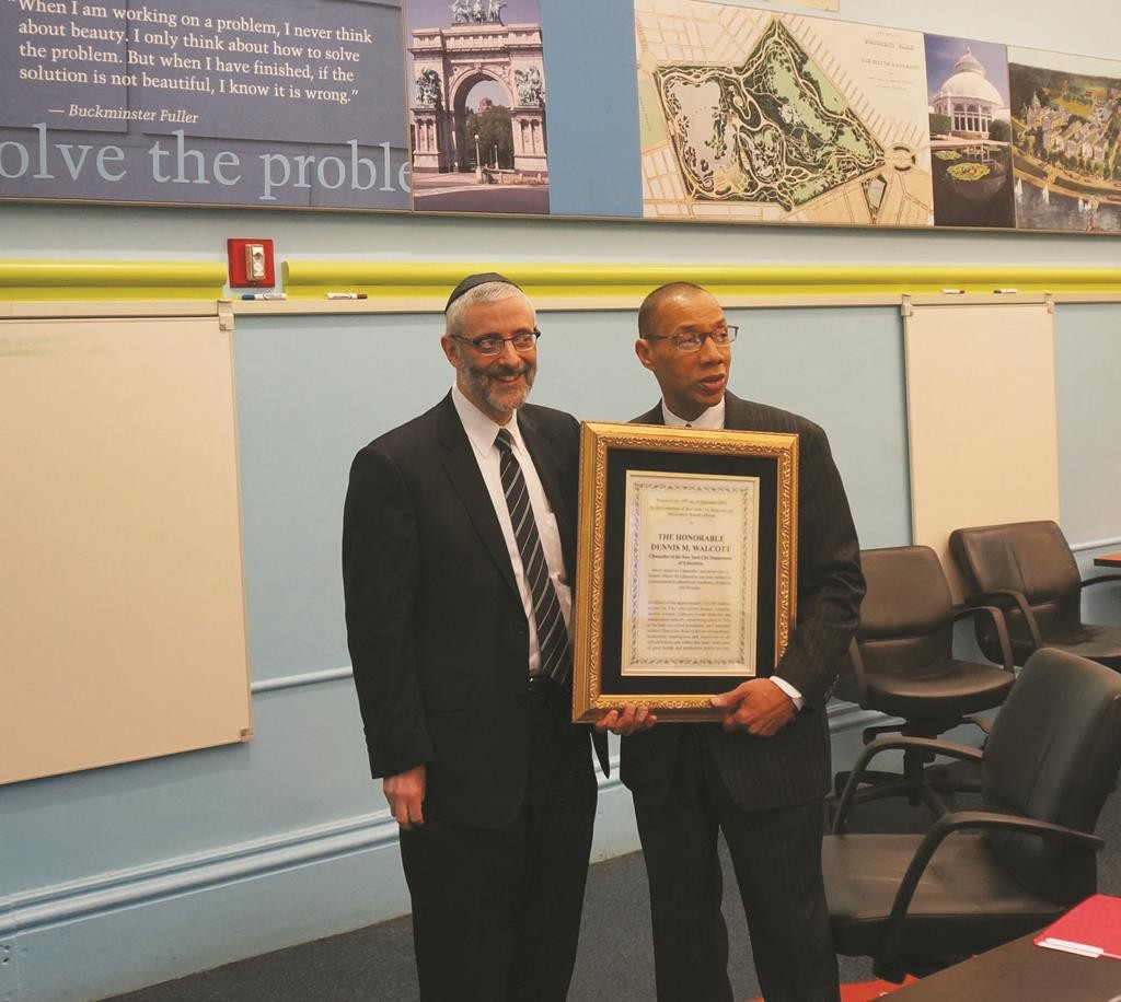 Dennis Walcott accepting an award from Agudath israel of America in 2013. (Agudath Israel)
