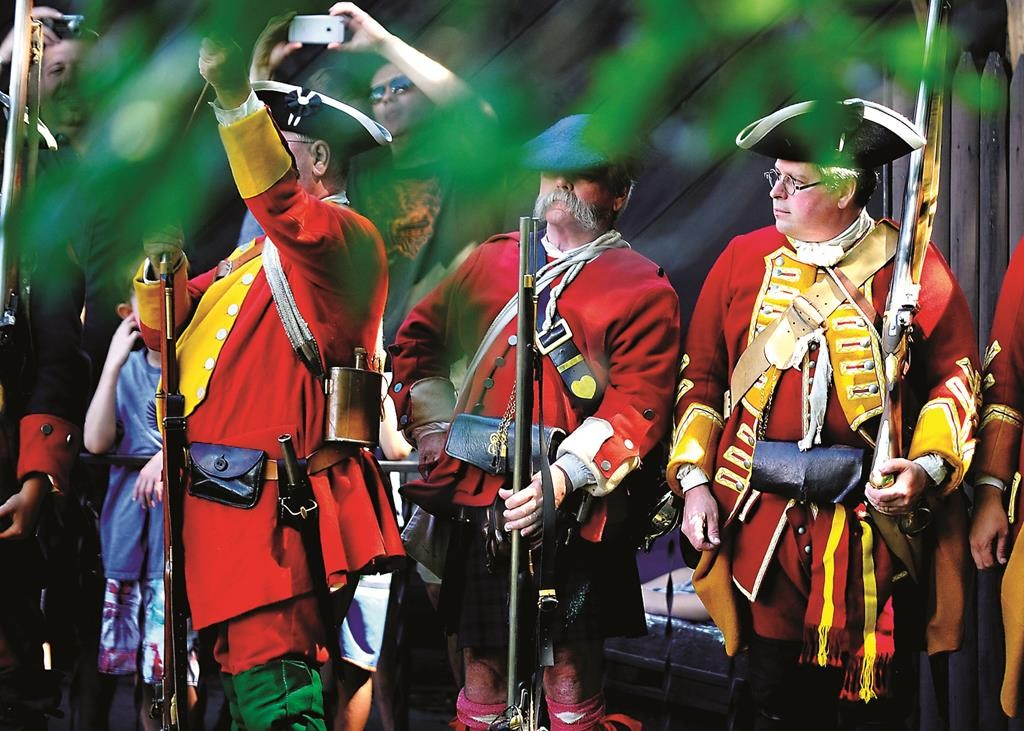 Re-enactors dressed in 1757 uniforms on Sunday celebrate the 258th anniversary of the surrender of Fort William Henry in Lake George, N.Y. (Steve Jacobs/The Post-Star via AP)