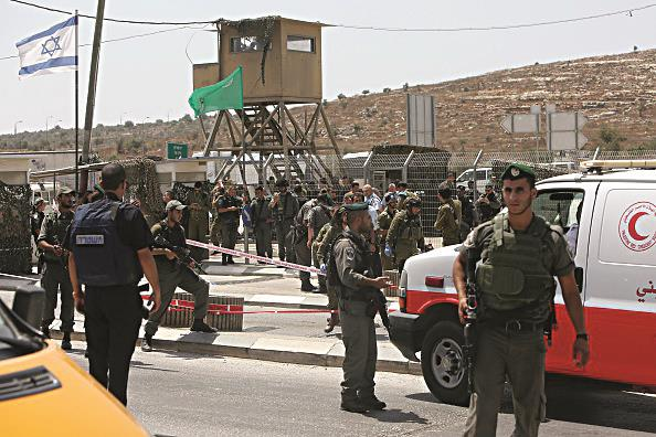 Israeli security forces stand guard near the Tapuah Junction checkpoint south in Shechem where a Palestinian terrorist was shot dead by Israeli troops after he stabbed a border police officer on Monday. (JAAFAR ASHTIYEH/AFP/Getty Images)