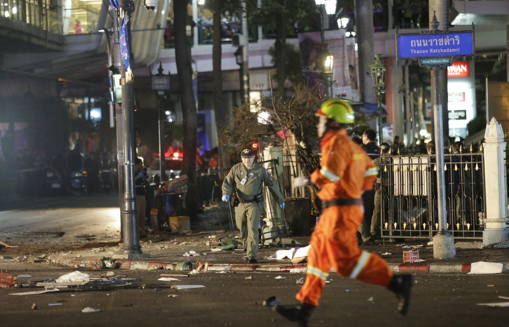 Emergency personnel at the scene after an explosion rocked a central Bangkok intersection during the evening rush hour, Monday, Aug. 17, 2015,  (AP Photo/Sackchai Lalit)