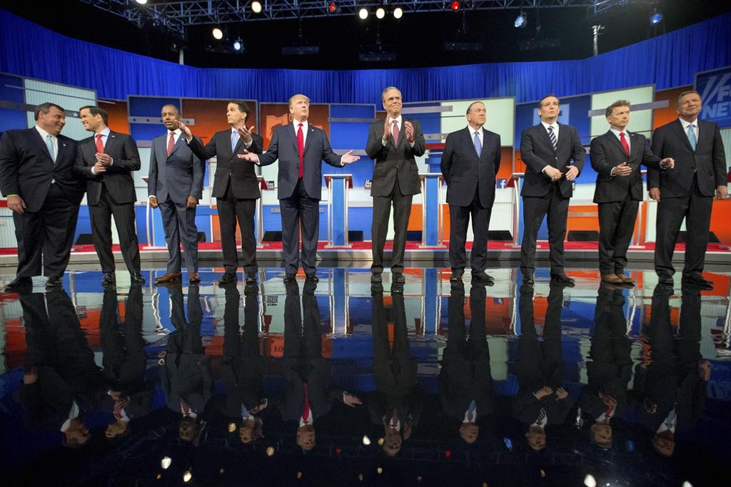 Republican presidential candidates from left: Chris Christie, Marco Rubio, Ben Carson, Scott Walker, Donald Trump, Jeb Bush, Mike Huckabee, Ted Cruz, Rand Paul and John Kasich take the stage for the first Republican presidential debate at the Quicken Loans Arena, Thursday, Aug. 6,  in Cleveland.  (AP Photo/Andrew Harnik)