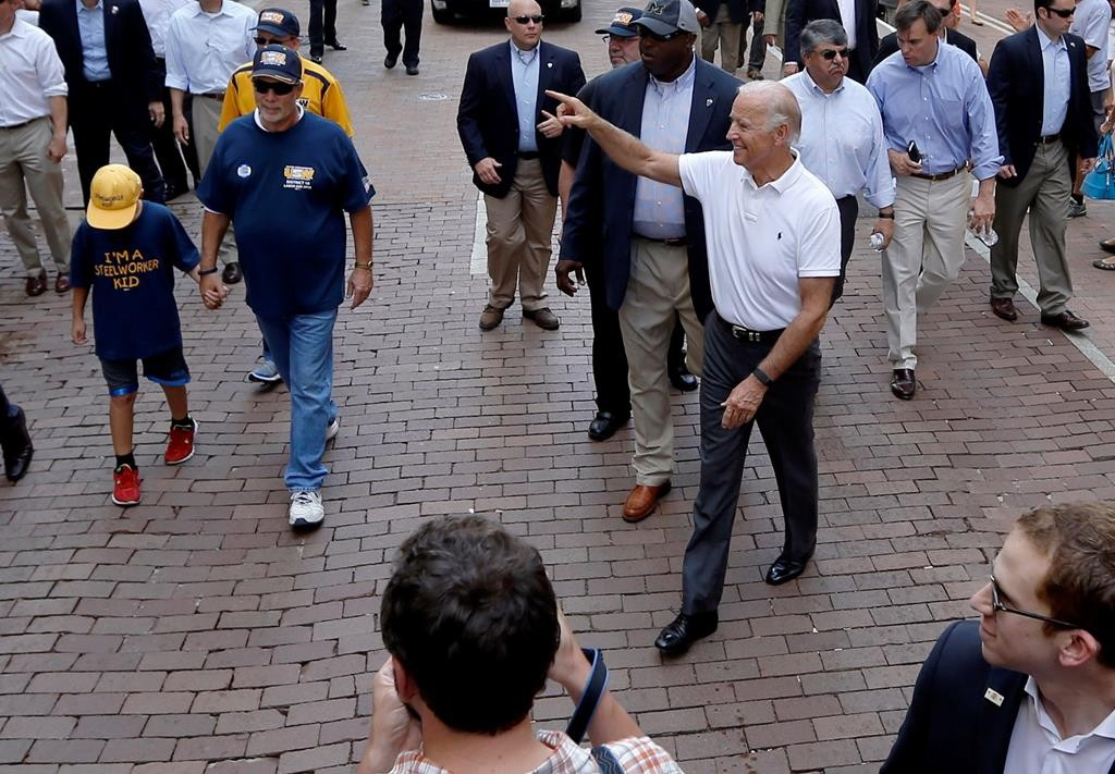 Vice President Joe Biden waves to the crowd Monday as he walks down Grant Street in Pittsburgh in their annual Labor Day parade. (AP Photo/Keith Srakocic)