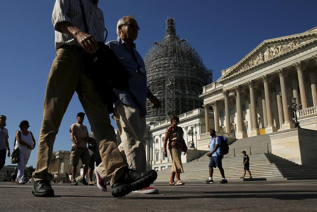 Tourists walk past the Capitol in Washington, D.C. Both houses of Congress resume work Tuesday as they return from summer recess.  (Reuters/Jonathan Ernst)
