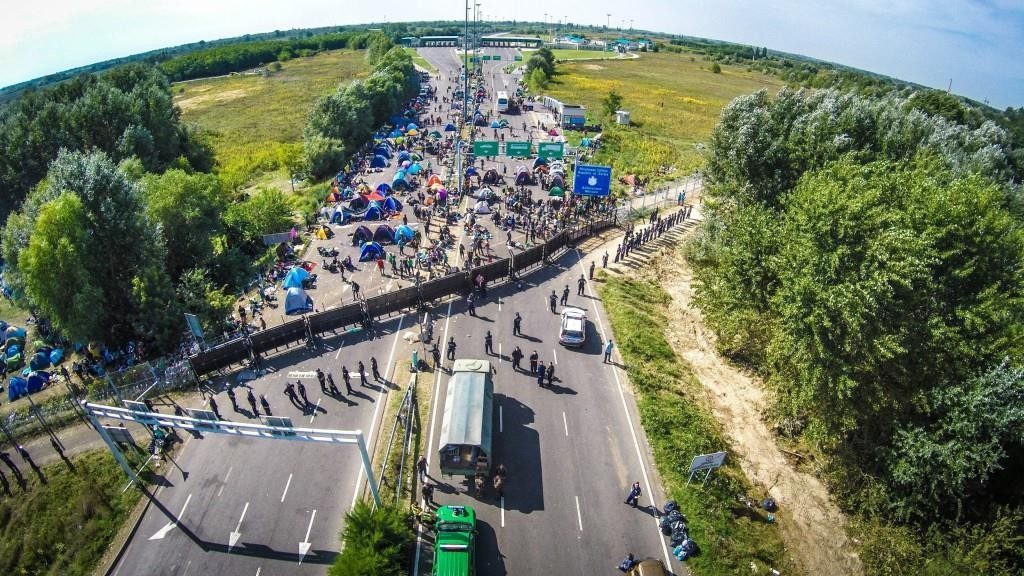 This picture, taken by a drone, shows stranded migrants at the border station between Serbia and Hungary near Horgos, Serbia, on Wednesday. (Istvan Ruzsa/MTI via AP)