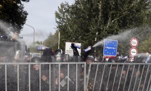 "Hungarian police use pepper spray at the ""Horgos 2"" border crossing into Hungary, near Horgos, Serbia, Wednesday.  (AP Photo/Darko Vojinovic)"