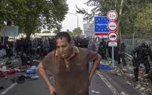 A migrant stands after clashing with Hungarian riot police at the border crossing with Serbia in Roszke, Hungary, Wednesday. (REUTERS/Marko Djurica)