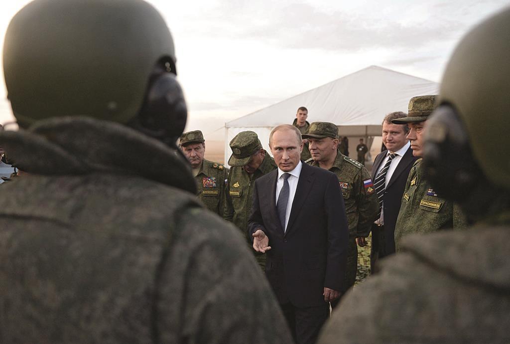 Russian President Vladimir Putin (C) meeting with officers after military exercises at Donguz range in Orenburg region, Russia.  (Alexei Nikolsky/RIA-Novosti, Kremlin Pool Photo via AP)
