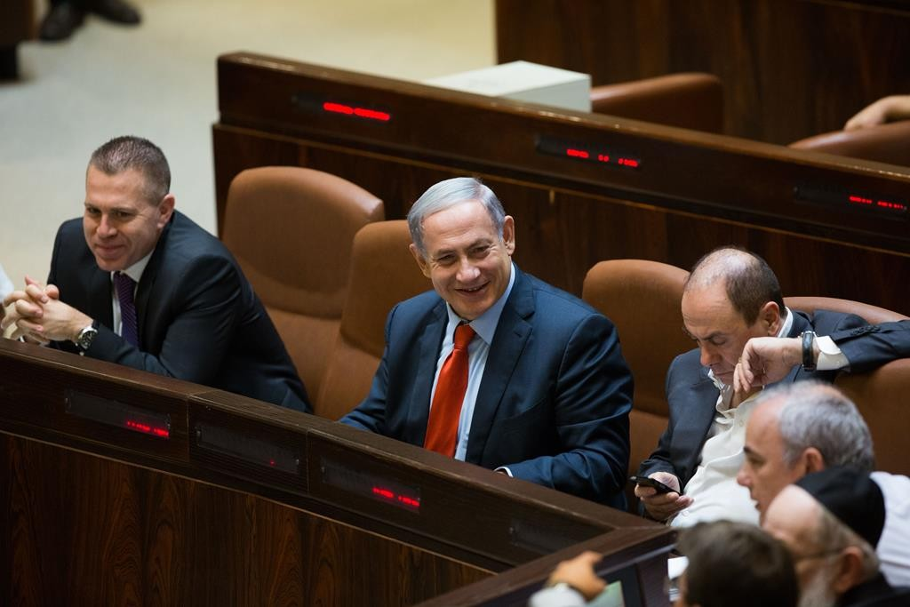 Israeli Prime Minister Binyamin Netanyahu and coalition partners in full smiles over the partial victory on the crucial natural gas deal in the Knesset on Monday. (Yonatan Sindel/Flash90)