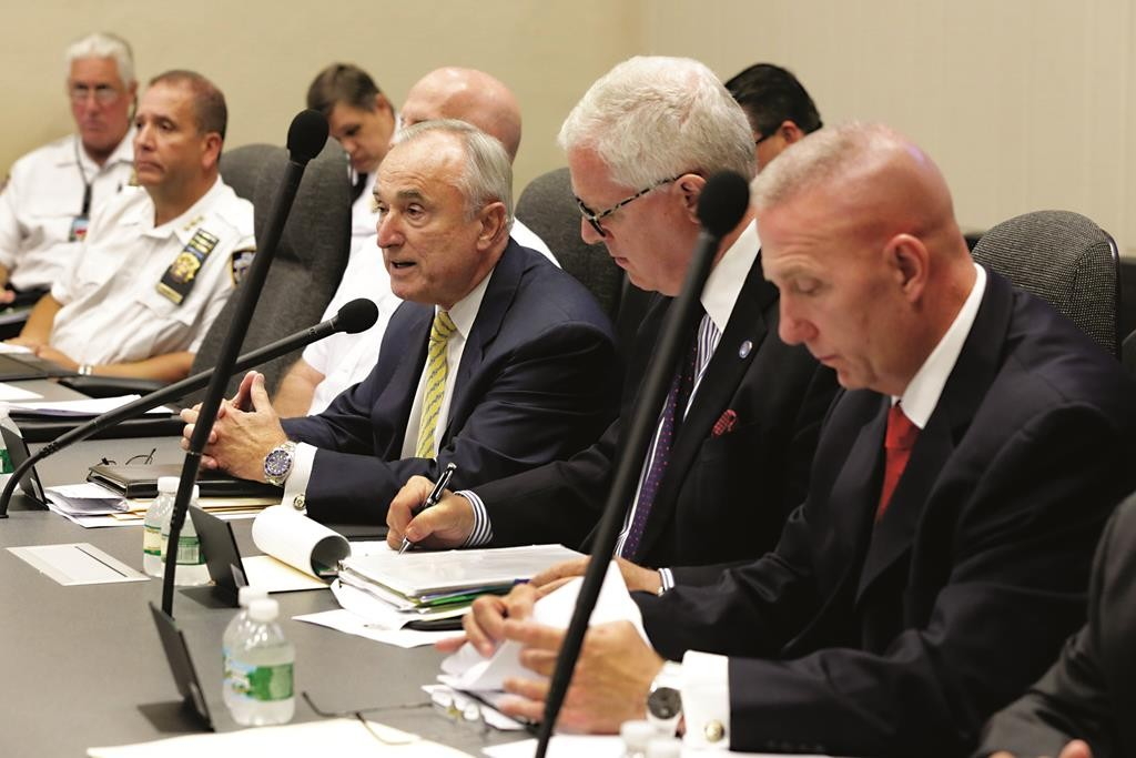 A meeting of law enforcement officials, including Commissioner William Bratton, third from right, on Wednesday attend the Executive Tabletop Exercise at Police Headquarters. (AP Photo/Richard Drew)