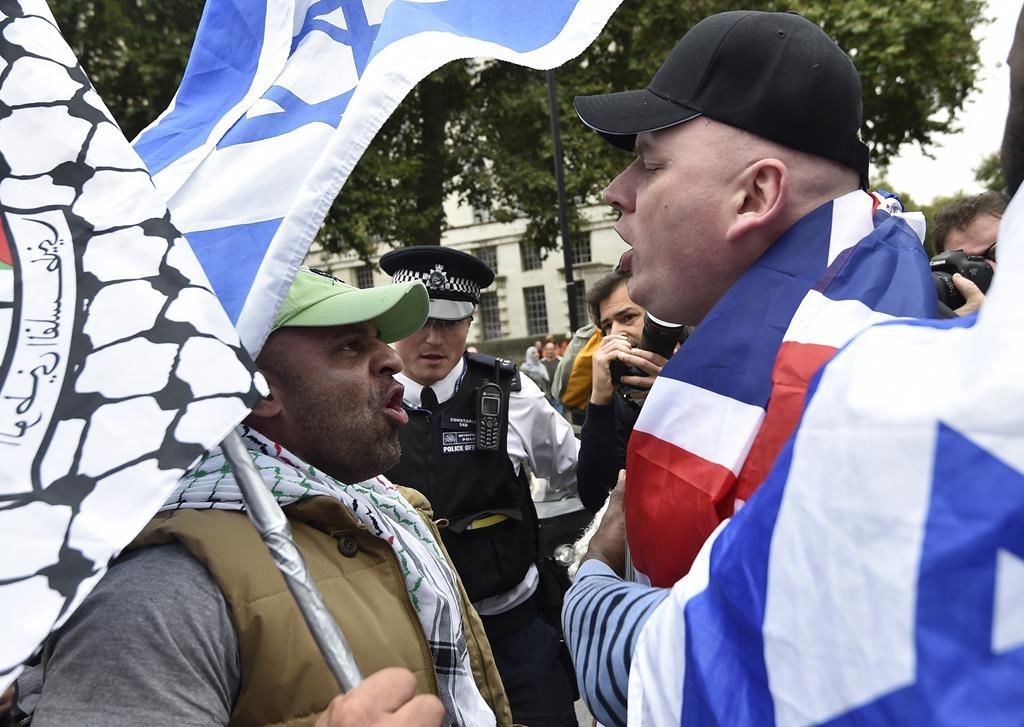 Demonstrators protest against Israeli Prime Minister Binyamin Netanyahu's visit outside Downing Street in London, Wednesday. (REUTERS/Toby Melville)