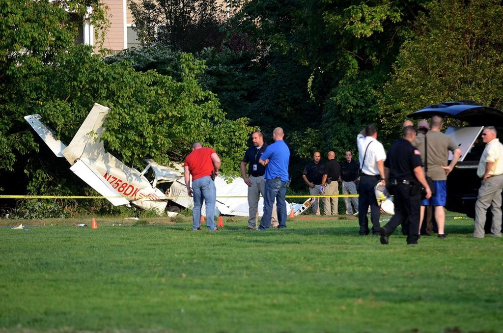 First responders gather on Thursday at the scene of a small plane crash in Cresskill, N.J., which seriously injured two members of the Coast Guard Auxiliary. (Bernadette Marciniak/The Record via AP)