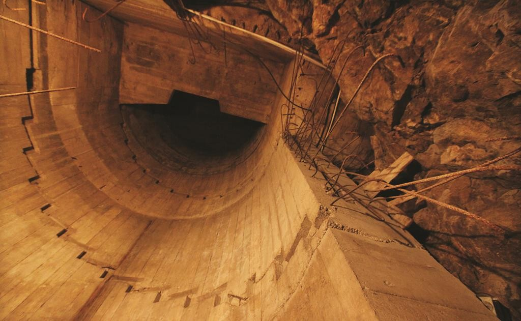 An evacuation tunnel, leading to massive shelters that are part of a giant system of tunnels and bunkers, under Ksiaz Castle in Walbrzych, Poland, Wednesday, Sept. 2, 2015. The Nazis most probably built it for Hitler.  (AP Photo/Czarek Sokolowski)