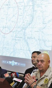 Explorer Krzysztof Szpakowski (R) with his legal advisor, at a news conference at the provincial governor's office in Walbrzych, Poland. (AP Photo)