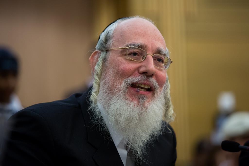 United Torah Judaism MK Rabbi Yisrael Eichler at the microphone during a recent Knesset meeting. (Yonatan Sindel/Flash90)