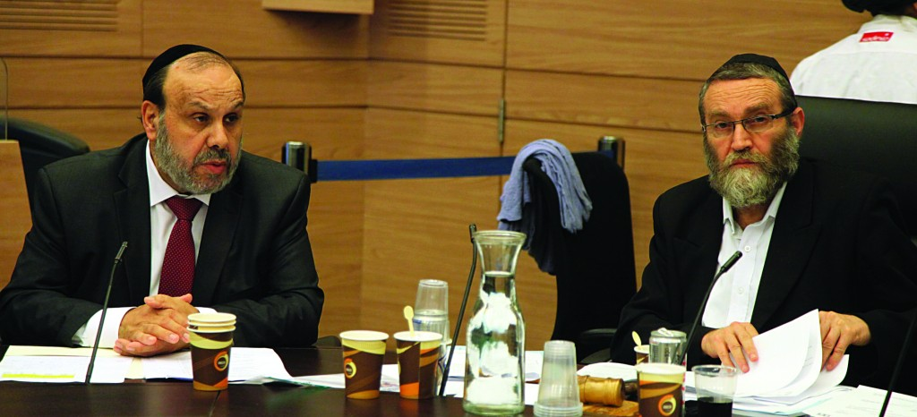 MK Rabbi Moshe Gafni, chairman of the Knesset Finance Committee, and MK Rabbi David Azulai, Minister of Religious Affairs, during the meeting of the Finance Committee, this morning. (Knesset Speaker)