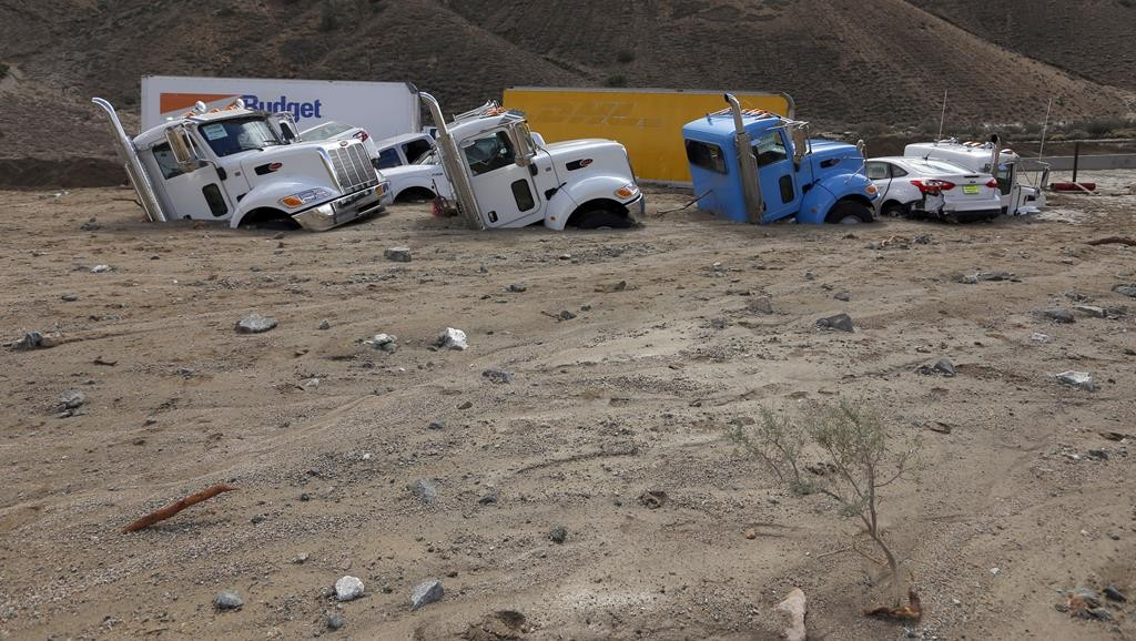 Nearly 200 vehicles, including 75 tractor-trailers, are trapped onCalifornia Highway 58east ofTehachapi, Calif., in up to 20 feet of mud and debris after torrential rains pummeled the area and forced drivers to flee. (Francine Orr/Los Angeles Times/TNS)