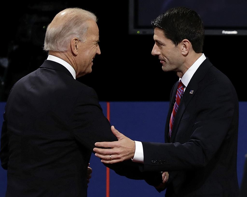 Vice President Joe Biden and then Republican vice presidential nominee Rep. Paul Ryan of Wisconsin shake hands after a vice presidential debate at Centre College, Thursday, Oct. 11, 2012, in Danville, Ky.  (AP Photo/Charlie Neibergall)