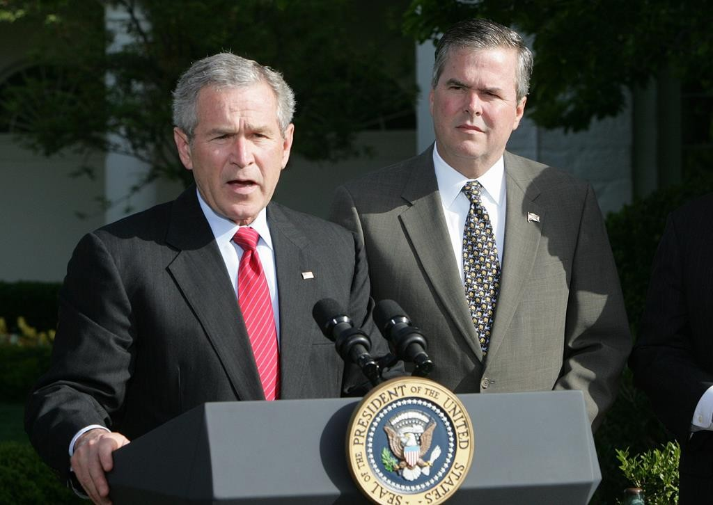 In this April 19, 2006 file photo, PresidentGeorgeW.Bush, accompanied by his brother, then-Fla. Gov. JebBush, speaks on the South Lawn at the White House in Washington. JebBushis tossing aside any hesitations about embracing former President GeorgeW.Bush'slegacy and is searching for new ways to incorporate him into his White House campaign. (AP Photo/Ron Edmonds, File)