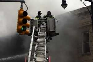 Firefighters work at the fire in Boro Park on October 3. (Spencer Platt/Getty Images)