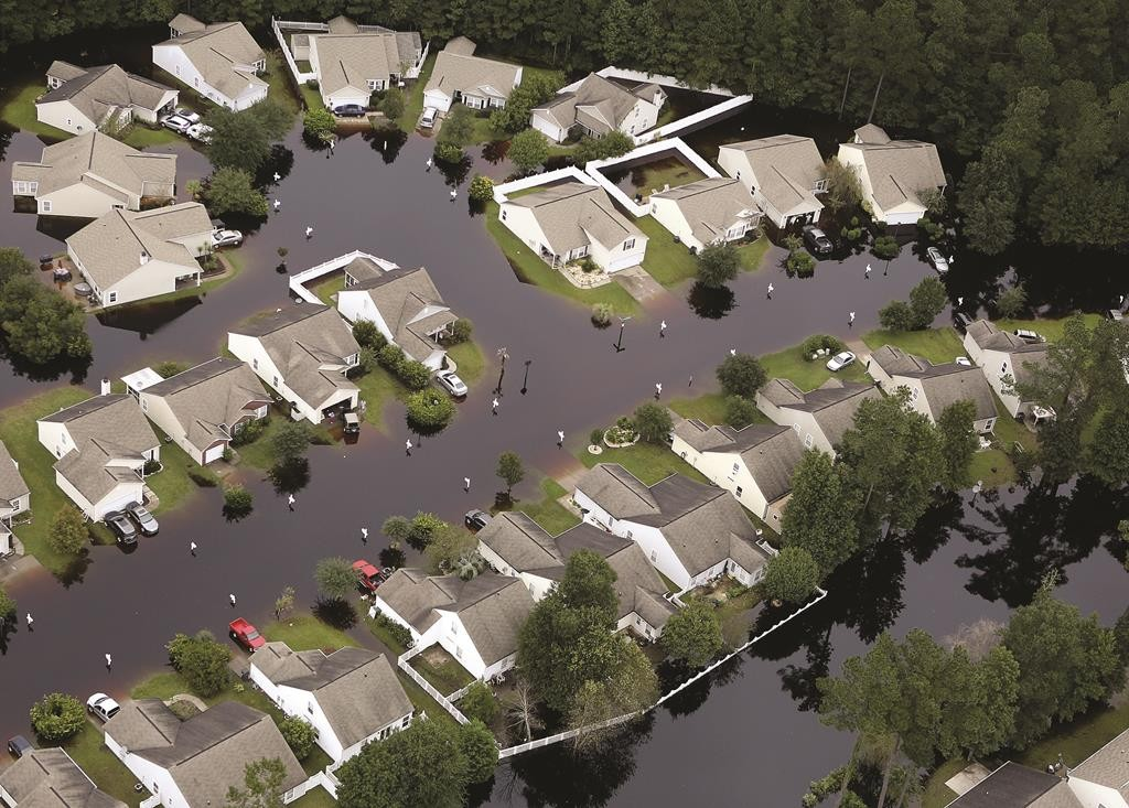 This aerial photo shows flooding around homes in the Carolina Forest community in Horry County, between Conway and Myrtle Beach, S.C.  (Janet Blackmon Morgan/The Sun News via AP)