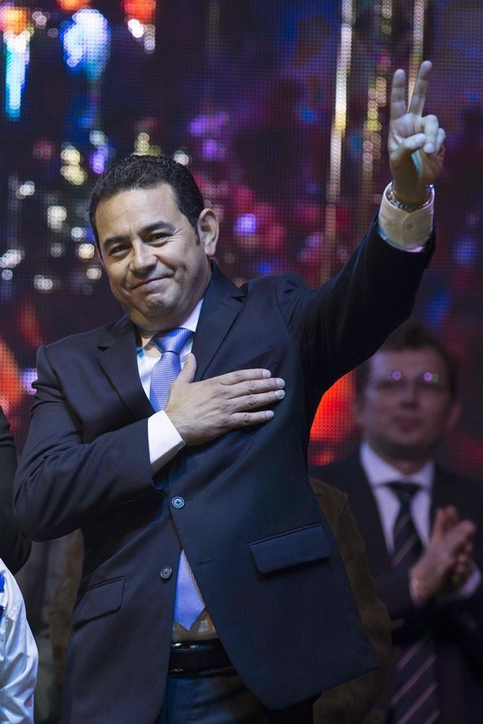 Jimmy Morales, the National Front of Convergence party presidential candidate, flashes a victory sign to supporters after winning the presidential runoff election in Guatemala City, early Monday.  (AP Photo/Luis Soto)