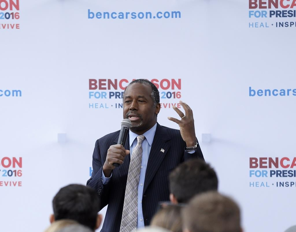 Republican presidential candidate Dr. Ben Carson speaks outside the Alpha Gamma Rho fraternity at Iowa State University during a campaign stop, Oct. 24, in Ames, Iowa. (AP Photo/Charlie Neibergall)