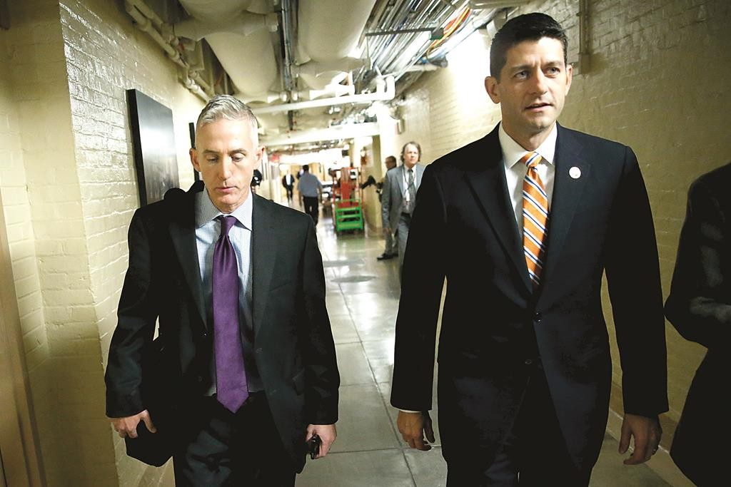 U.S. Representative Trey Gowdy (R-SC) (L) and Representative Paul Ryan (R-WI) (R) arrive for a Republican caucus meeting at the U.S. Capitol in Washington, on October 9. (REUTERS/Jonathan Ernst)