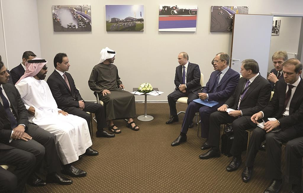 Russian President Vladimir Putin (center R) meets with Abu Dhabi's Crown Prince Sheikh Mohammed bin Zayed Al Nahyan (center L) in Sochi, Russia, Sunday. Putin met with Prince Mohammed on Sunday to discuss security in the Middle East and the conflict in Syria.  (REUTERS/Alexei Nikolsky/RIA Novosti/Kremlin)
