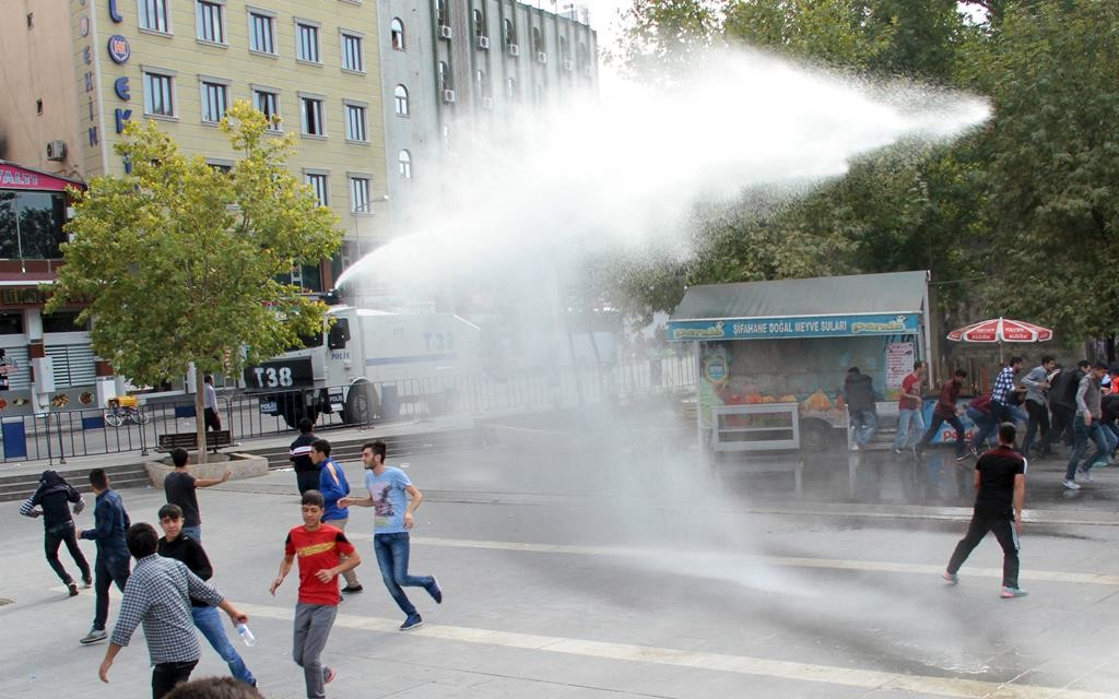 Riot police use a water cannon to disperse demonstrators during a protest against Saturday's bomb blasts in Ankara, in the Kurdish dominated southeastern city of Diyarbakir, Turkey, Monday. (Reuters/Sertac Kayar)
