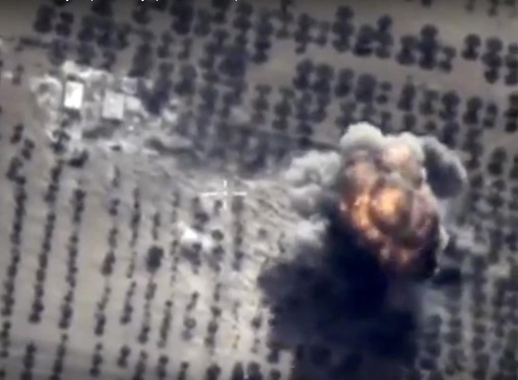 Footage taken from Russian Defense Ministry official website on Friday, Oct. 16, shows a target hit during a Russian air raid in Syria. Russian Defense Ministry said the strike was performed by an Su-24M bomber in Idlib province. (AP Photo/ Russian Defense Ministry Press Service)