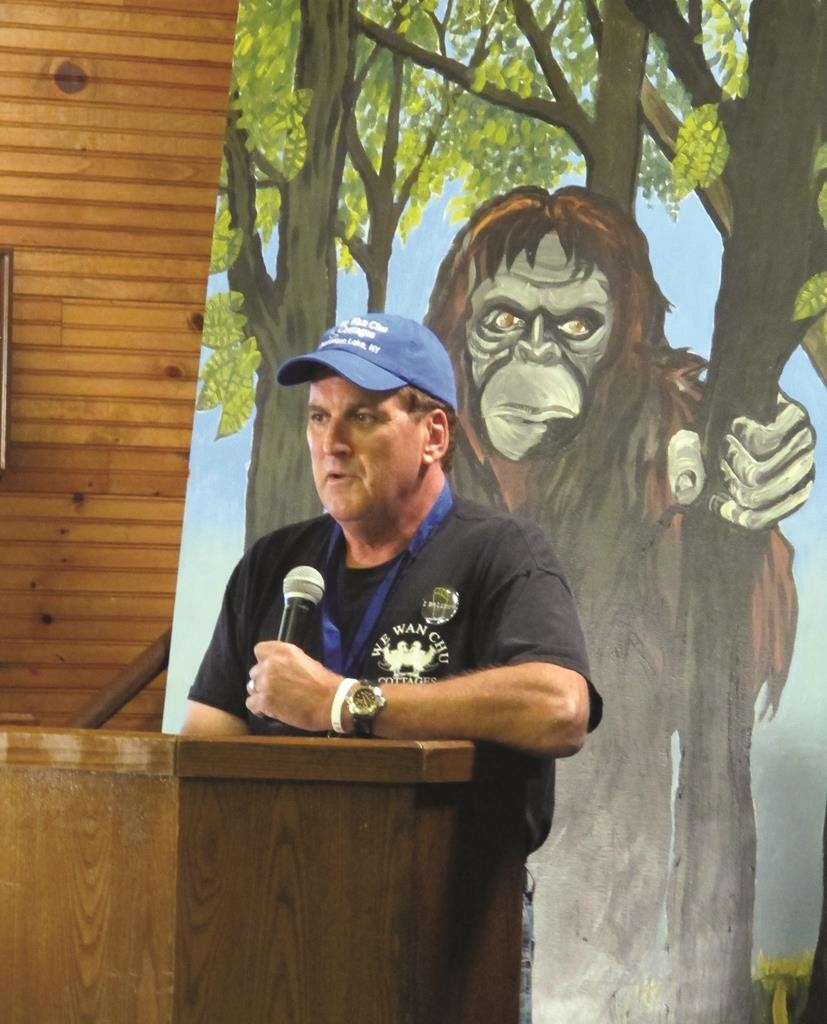 Peter Wiemer delivers opening remarks Saturday at the Bigfoot Expo in Chautauqua, N.Y. (AP Photo/Carolyn Thompson)