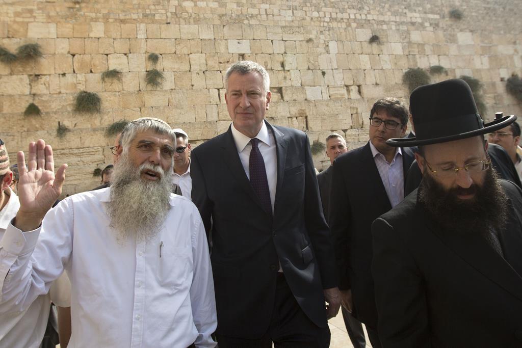 Mayor Bill de Blasio on Sunday leaves the Kosel during his three-day visit to Israel. (AP Photo/Sebastian Scheiner)