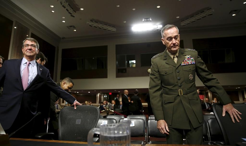 "Secretary of Defense Ash Carter (L) and Joint Chiefs of Staff Chairman USMC General Joseph Dunford, Jr. sit down before testifying at a Senate Armed Forces Committee hearing on ""United States Strategy in the Middle East"" in Washington, Tuesday.   (REUTERS/Gary Cameron)"