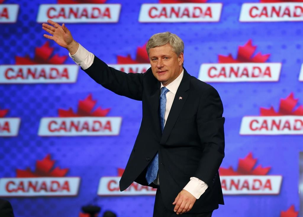 Canada's Prime Minister Stephen Harper waves as he walks off the stage after giving his concession speech following Canada's federal election in Calgary, Alberta, Monday night   (REUTERS/Mark Blinch)
