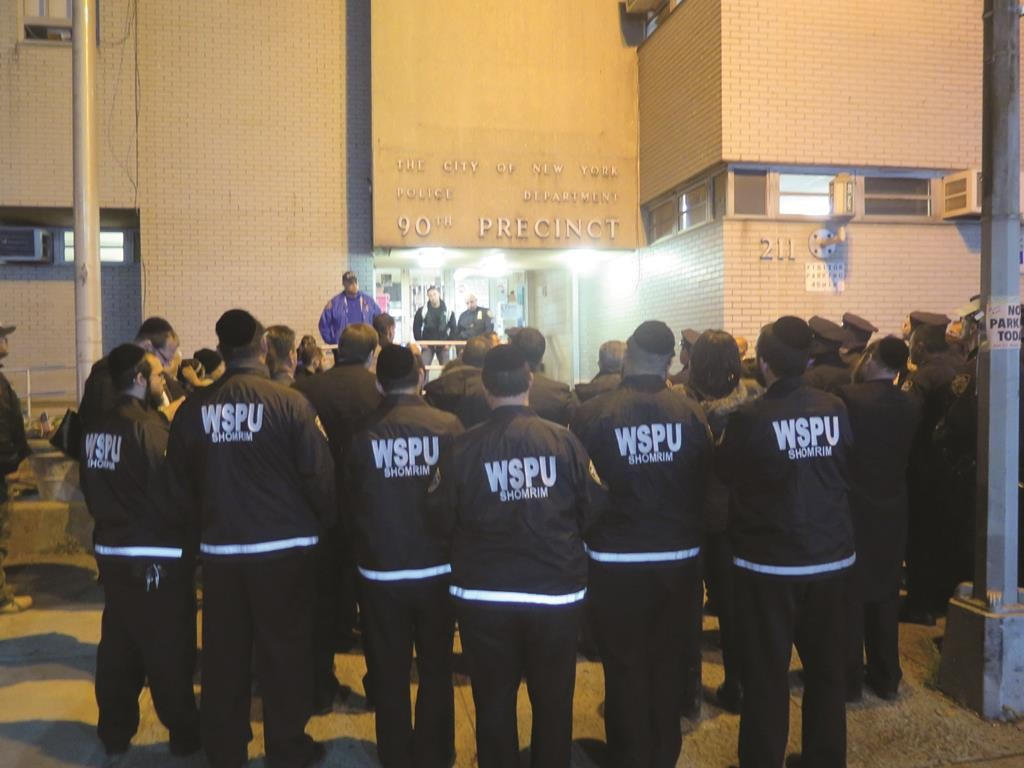 Boro Park Shomrim members attend a vigil Monday night in memory of slain Officer Randolph Holder in front of the NYPD's 66th Precinct. (JDN)