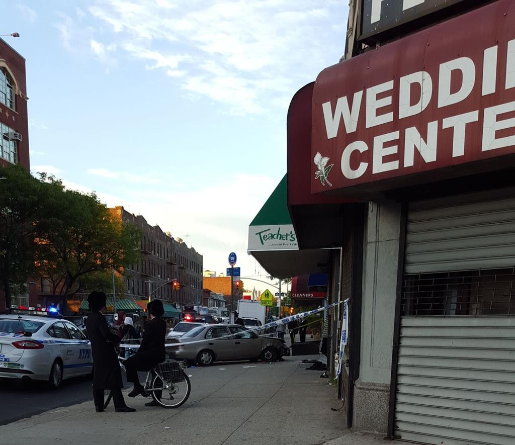 The scene of the accident early Wednesday in which a car struck two pedestrians on Boro Park's 18th Avenue and 47th Street. (CAR)