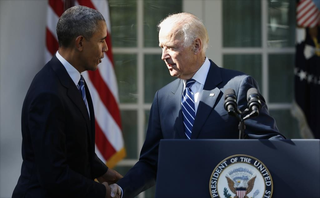 Vice President Joe Biden (R) shakes hands with President Barack Obama after Biden announced he will not seek the 2016 Democratic presidential nomination, during an appearance in the Rose Garden of the White House in Washington, Wednesday.  (REUTERS/Carlos Barria)