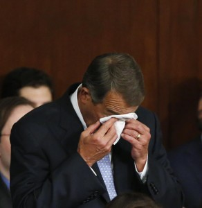Outgoing Speaker of the U.S. House of Representatives John Boehner (C) cries at the back of the House chamber as Rep. Paul Ryan is sworn in to succeed Boehner.  (REUTERS/Jonathan Ernst)
