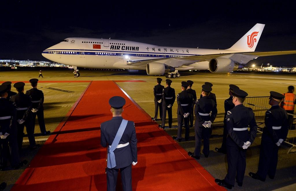 A plane carrying Chinese President Xi Jinping and his wife arrives at London's Heathrow Airport, Monday. Xi will be feted by the royal family and leading politicians during the trip, which Prime Minister David Cameron hopes will cement Britain's place as China's closest friend in the West.  (REUTERS/Toby Melville)