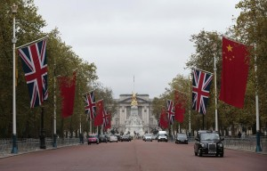 Chinese and British flags fly in front of Buckingham Palace on the Mall in London, Britain Monday.  (Reuters/Suzanne Plunkett)