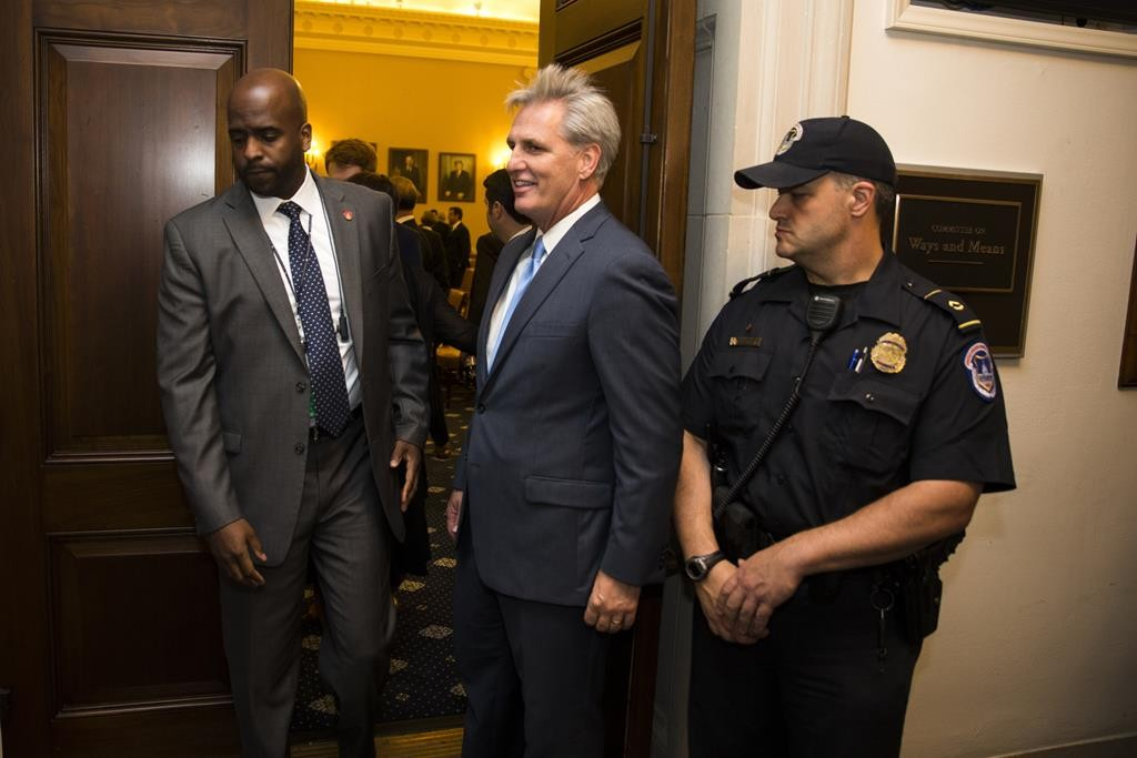 House Majority Leader Kevin McCarthy of Calif. walks out of nomination vote meeting on Capitol Hill in Washington, Thursday, after dropping out of the race to replace House Speaker John Boehner.  (AP Photo/Evan Vucci)