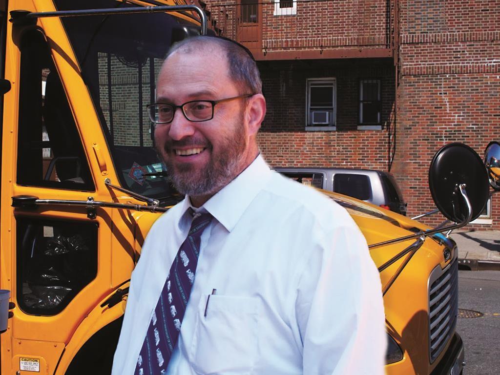 State Sen. Simcha Felder on Tuesday stands in front of a school bus in Boro Park. (Office of Sen. Felder)