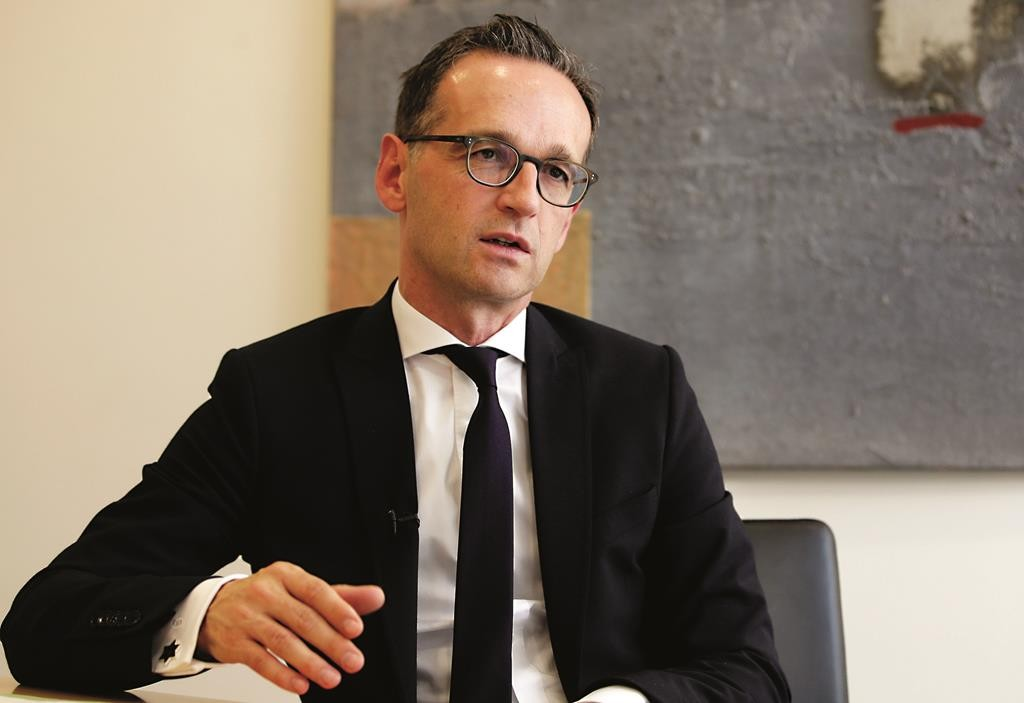 German Minister of Justice Heiko Maas speaks during an interview with the Associated Press at the ministry in Berlin, Germany.  (AP Photo/Michael Sohn)