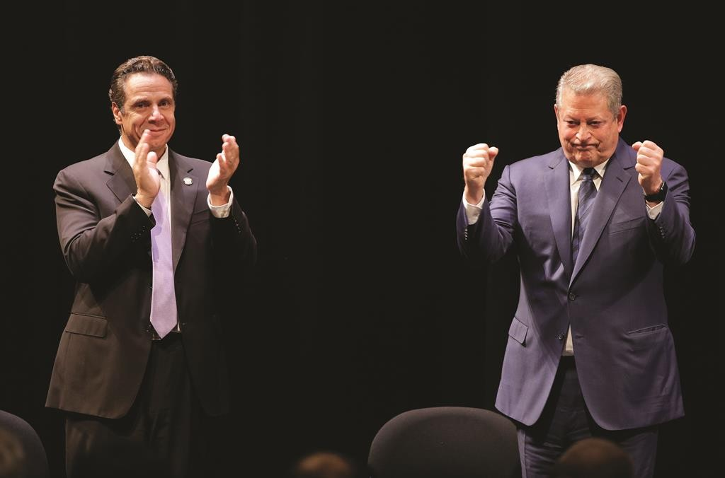 Gov. Andrew Cuomo, left, and former Vice President Al Gore on Thursday react to applause after announcing, New York's involvement in the Under 2 MOU coalition. (AP Photo/Julie Jacobson)