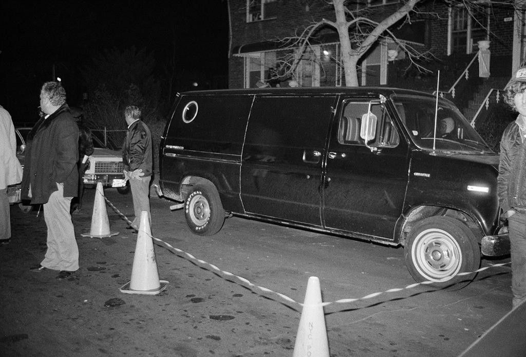 Police cordon off an area around a stolen black van discovered in Brooklyn on Dec. 13, 1978. The van was used by the Lufthansa heist thieves who escaped with $6 million. (AP Photo/Ken Murray)