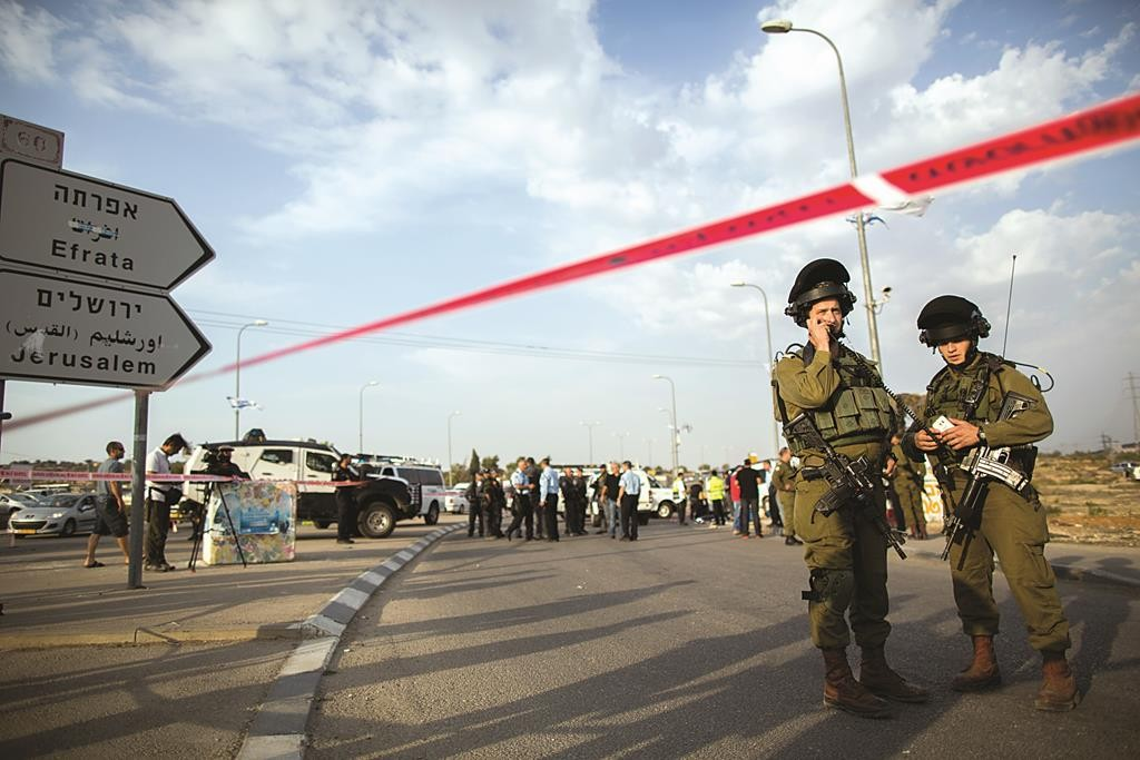 Israeli security forces at the site of a terror attack near the Gush Etzion Junction on Tuesday. (Yonatan Sindel/FLASH90)