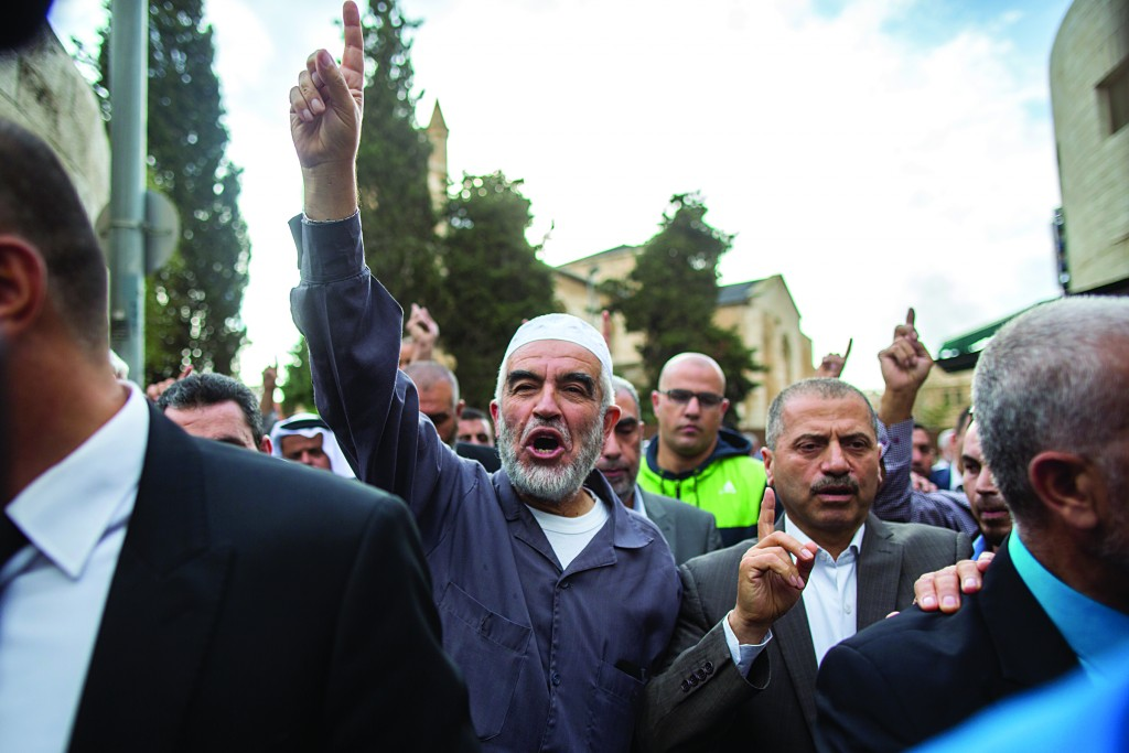 Leader of the Northern Branch of the Islamic Movement in Israel, Sheikh Raed Salah, with his supporters outside the Yerushalayim District Court where he was sentenced on Tuesday. (Yonatan Sindel/Flash90)